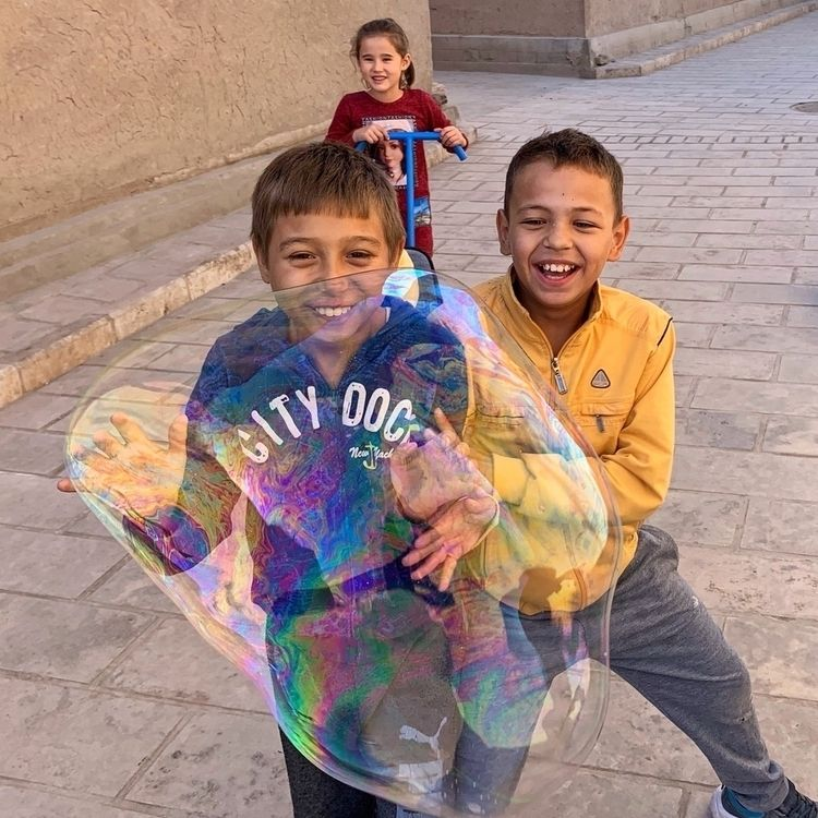 Happiness spreading - khiva, uzbekistan - kyphotos | ello