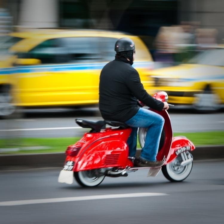 Red_scooter_rider_Avenida_Do_Mar,_Funchal,_Madeira_Island.jpg