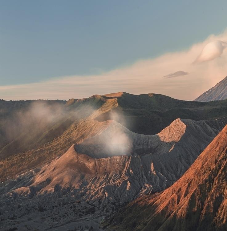 Fiery light day creeps volcano  - jonathansander | ello
