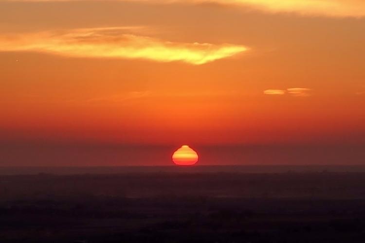 Atmospheric Refraction Sunrise  - chrishuddleston | ello