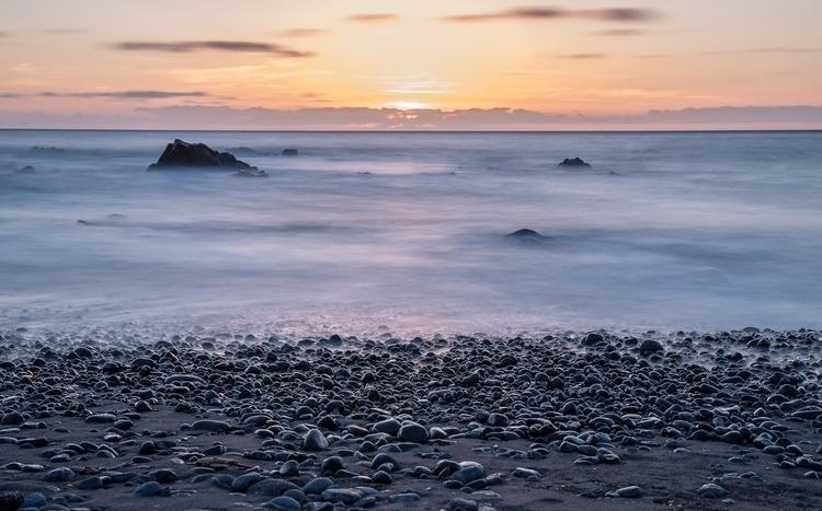 Long exposure sunset North Atla - konradphoto | ello