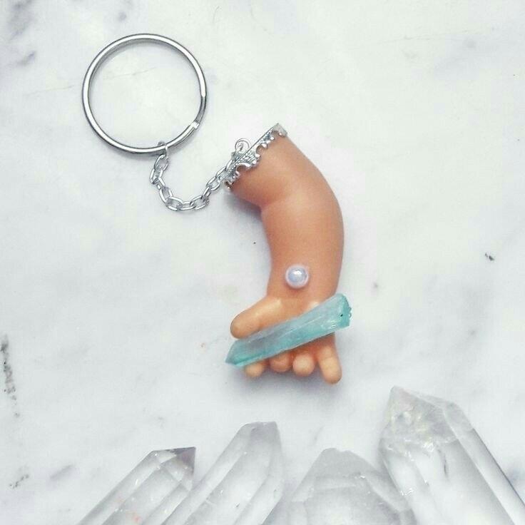 keychain features hand grabbing - theglamouraiwarrior | ello