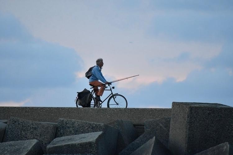 Man, bike fishing gear - scheveningen - rwhfink | ello