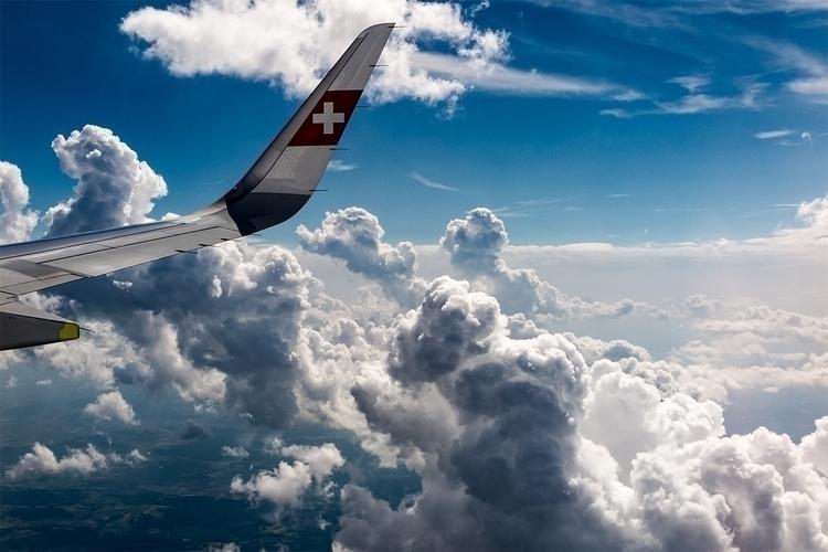 flight Barcelona Zurich - clouds - stephanepictures | ello