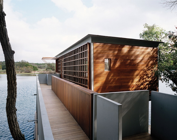 boathouse sits Lake Austin Ande - elloarchitecture | ello