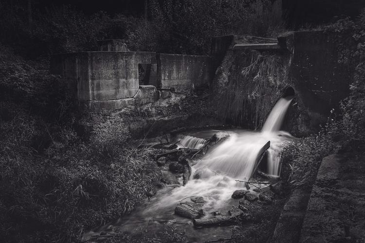 Water flows concrete dam ruins  - scottnorrisphotography | ello