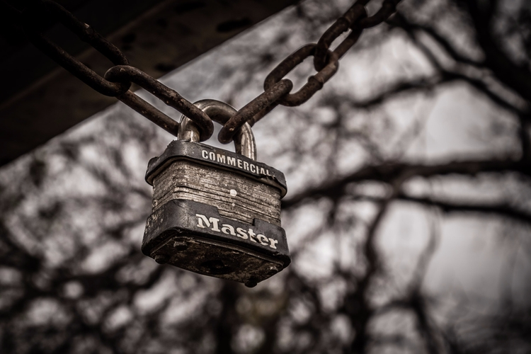 Locked padlock hangs chain Rich - mattgharvey | ello