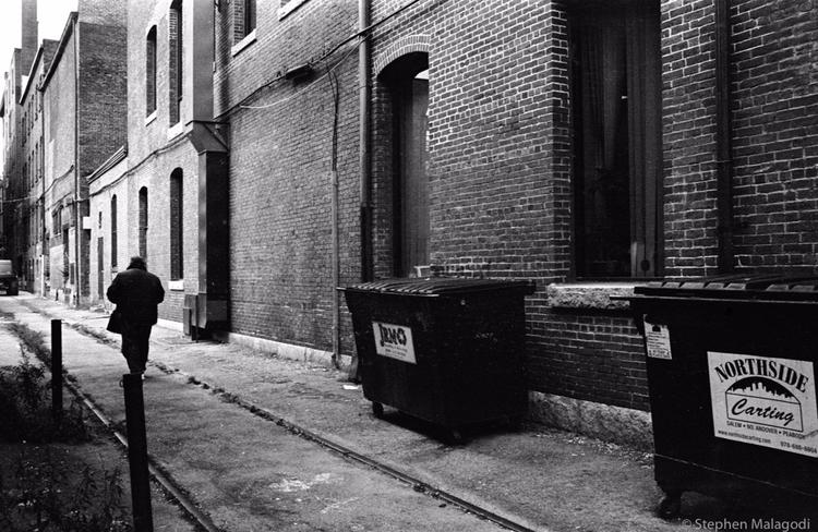 man walks alley, motionless - malagodi | ello
