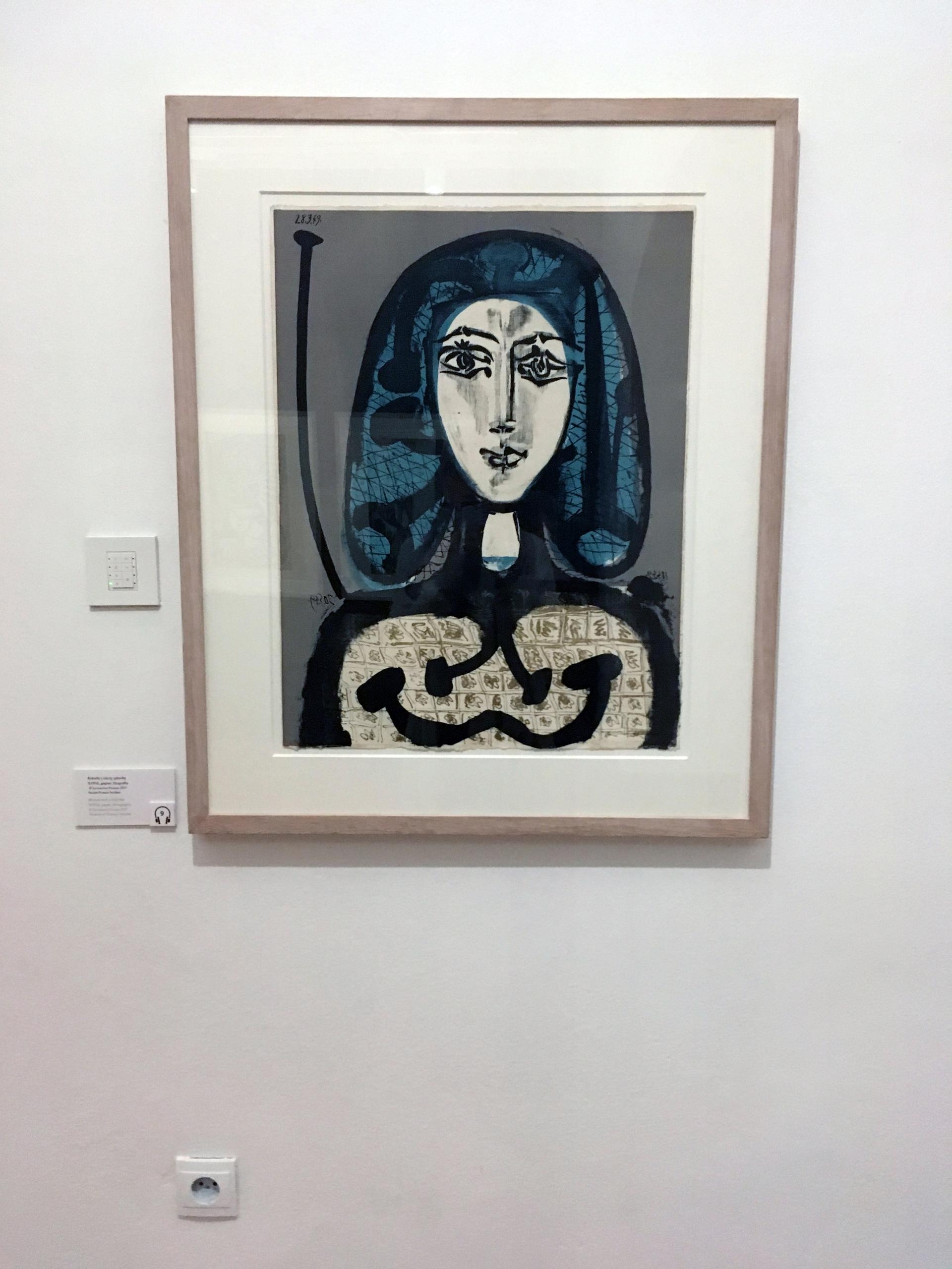 Zdjęcie przedstawia jedną z grafik znanego artysty Pabla Picassa. Grafika przedstawia portret kobiety.