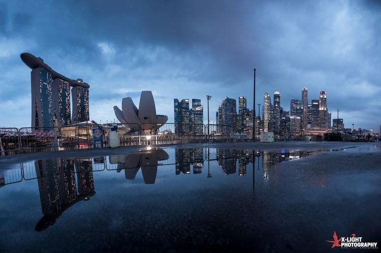 Puddle reflection. Singapore la - wxzhuo   ello