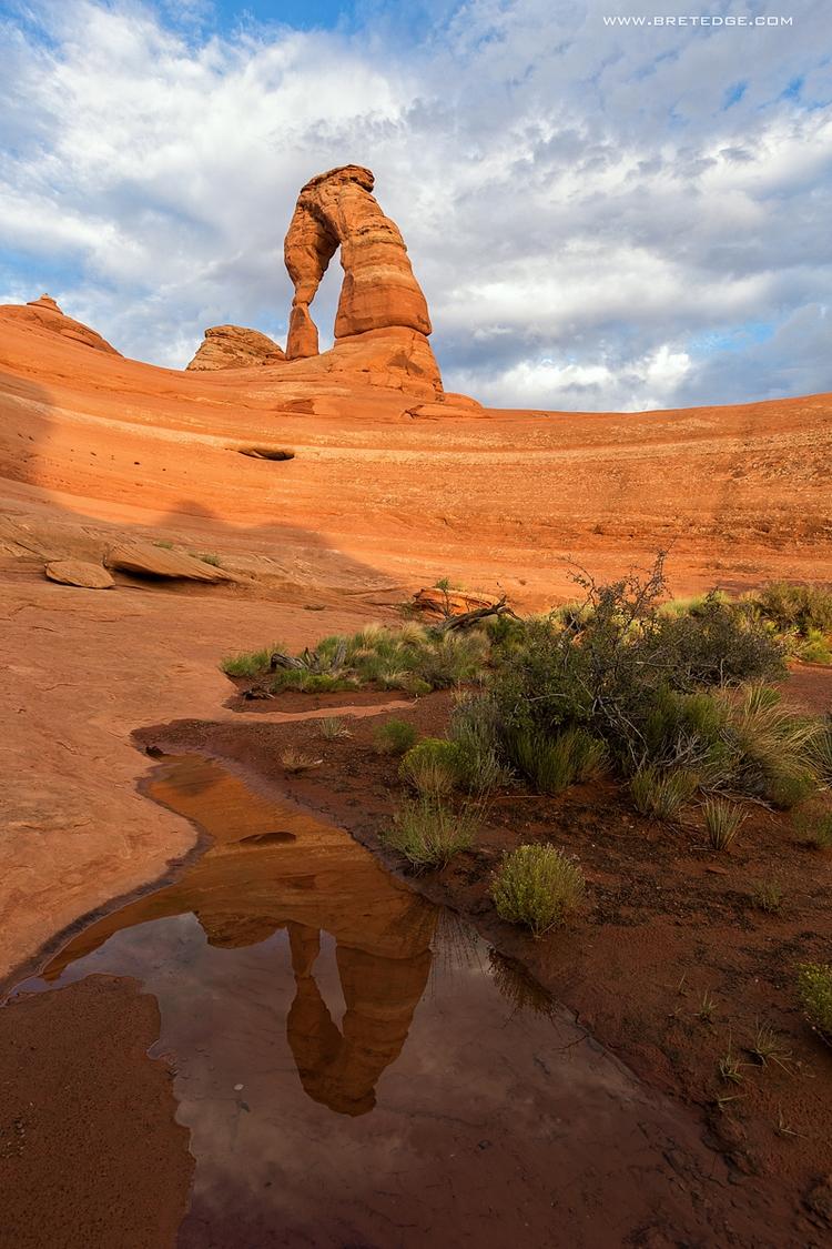 Delicate Arch reflects pothole  - bretedge   ello