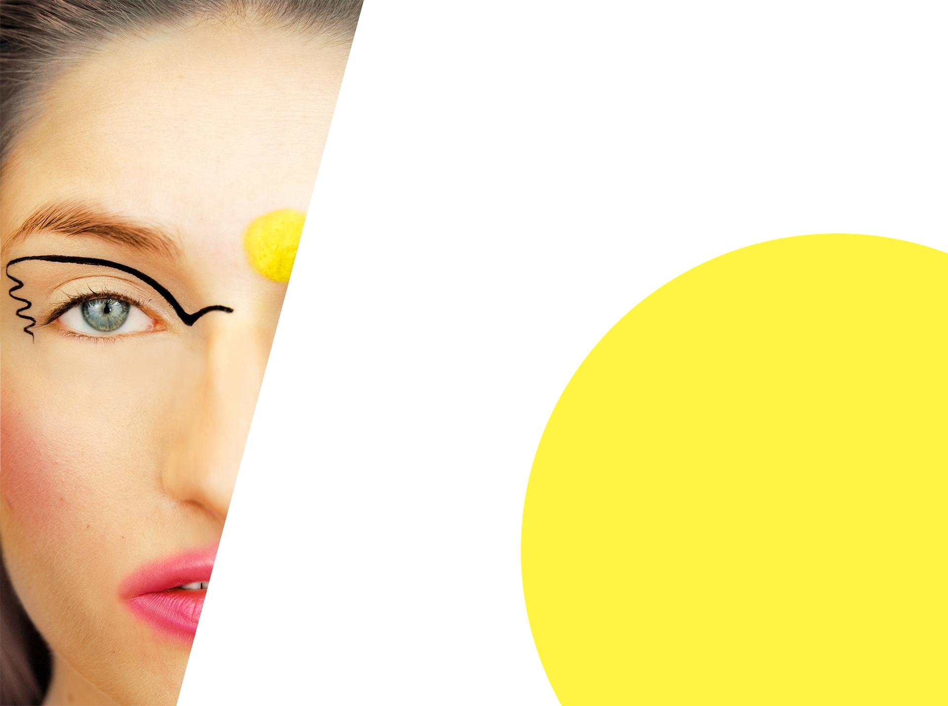 Zdjęcie przedstawia połowę twarzy kobiety w artystycznym makijażu, a obok widzimy wielkie żółte koło wystające poza kadr.