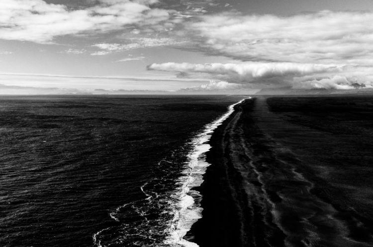 Black waters frozen shore waiti - armandnourphoto | ello