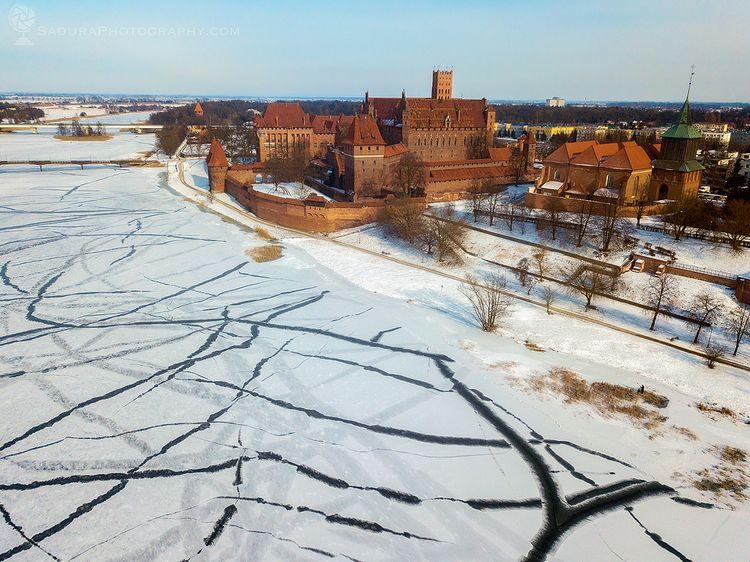 Malbork Castle frozen Nogat Mal - hsphotos | ello