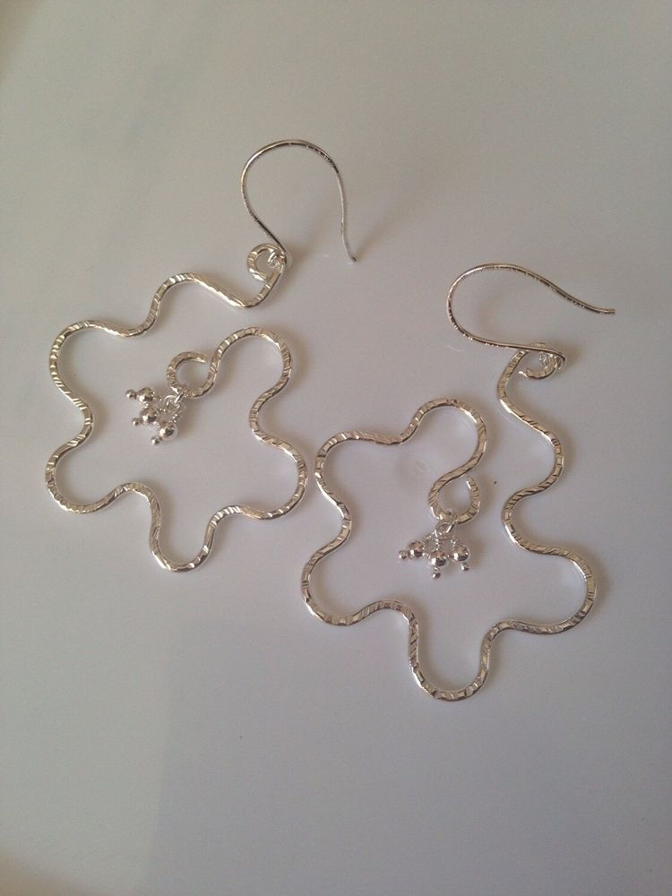 Super groovy earrings $18 - lollypopsparade   ello