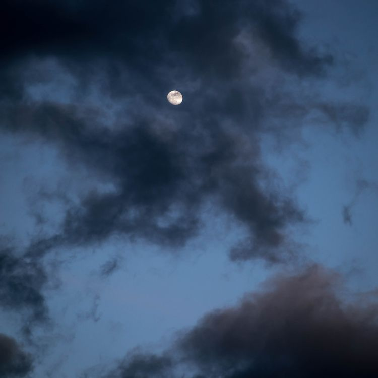 moon pokes clouds stormy night  - toddhphoto | ello