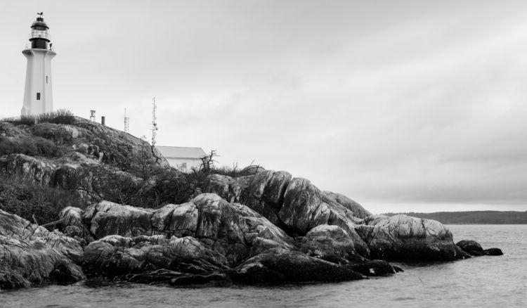 Good Evening, Lighthouse Point  - rhinocerous | ello