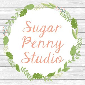 DonaJT (@sugarpennystudio) Cover Image