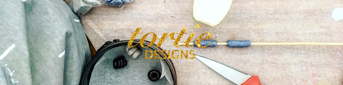 Tortie Designs (@tortiedesigns) Cover Image